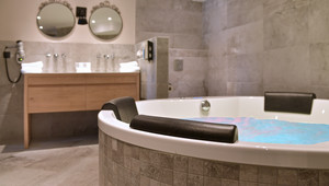 Open bathroom with XL jacuzzi